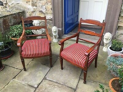 Early twentieth century mahogany arm chairs in red chenille stripe