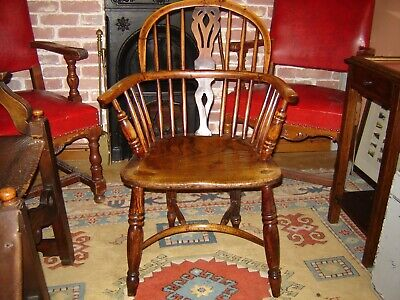 Early 19c yew and elm Windsor Armchair with crinoline stretcher