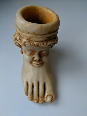 LToni figure of a foot and smiling face - see photos.