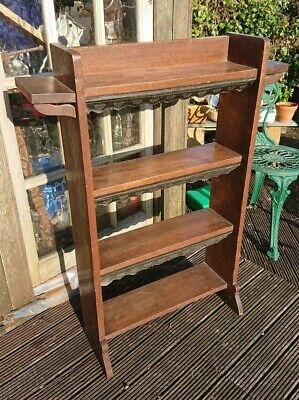 Arts And Crafts Style Oak Bookcase candle shelfs. Leather embossed decorated