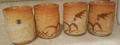 Unique set of 4 Japanese/Chinese art pottery signed cups