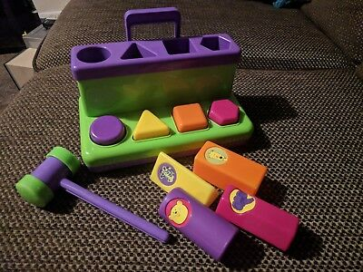 Hammer and Bench with pop up shapes. Young child. Colourful.