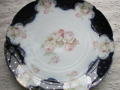 Antique cobalt blue plate with stars & Roses. Stunning