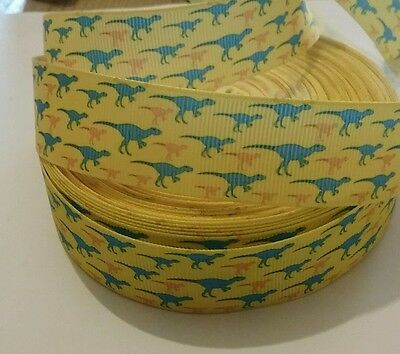 1m g/gr ribbon 25mm yellow with blue & orange dinosaurs jurassic t rex