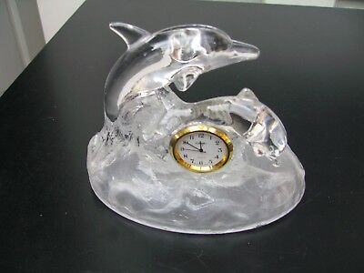 Lead crystal dolphins on plinth with inset clock