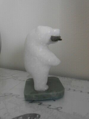 Beautiful hand carved stone/jade polar bear holding a fish in it's mouth