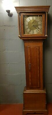 Brass dial striking 30 hour longcase clock in a oak case spares or repair