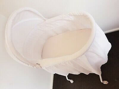 Round bassinet with wheels.