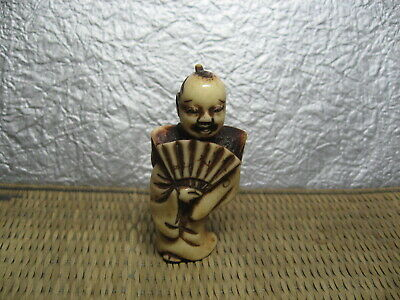 Japanese Netsuke Staghorn Mikawa Manzai Dancer has Fan carved in Edo era