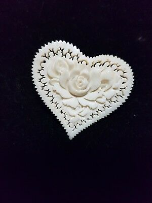 A Carved Heart With A Flower