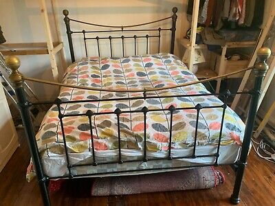king size bed used iron frame with brass knobs
