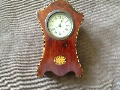 small antique clock with inlay