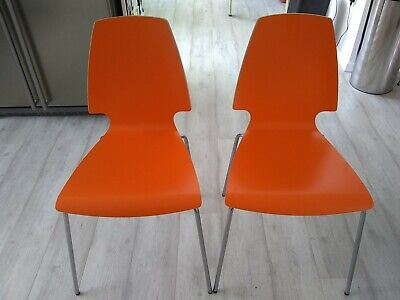 Lovely pair of bright orange wooden kitchen chairs