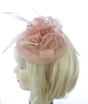 Beautiful NUDE Fascinator looped with feathers on a band weddings, races, prom