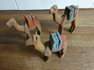 3 x vintage hand carved wooden camels  9 cm Tall