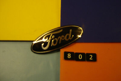 NEW OLD STOCK FORD FIESTA OVAL CURVED INSERT BADGE EMBLEM. 80mm x 30mm