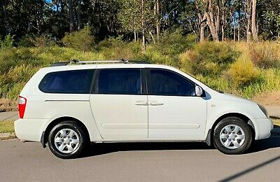 2010 KIA GRAND CARNIVAL VQ EXE PEOPLE MOVER 8 SEATS 5SP  3.8i WHITE AUTOMATIC