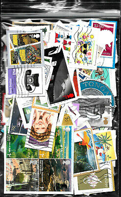 Over 150 used world postage stamps on paper taken from Kiloware.