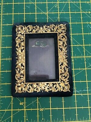 Old velvet picture frame with brass moulding