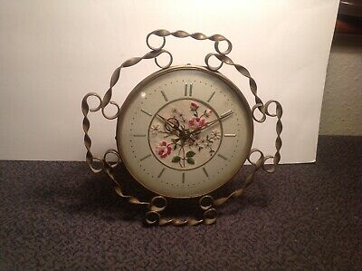 FLORAL . CLOCK, Made in Great Britain, working fine.