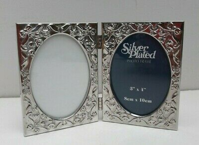"""Small vintage double Silver plated Photo Frame for a  3 x 4"""" picture."""