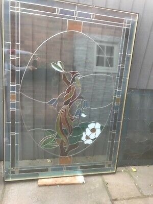 Stained glass panel with peacock design