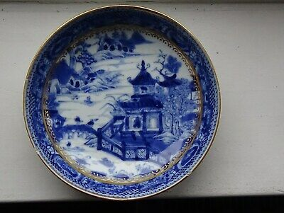 A Chinese porcelain blue and white 16cm dish from late 18thc. Gilded in England.