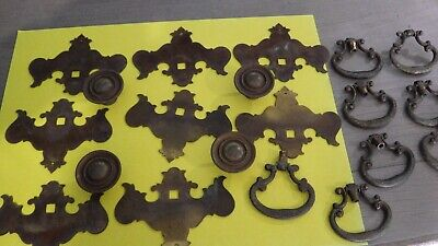 Eight brass vintage drawer pulls and four knobs