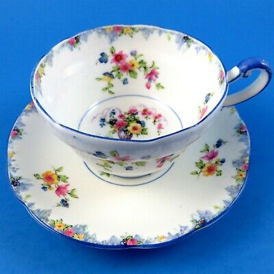 Floral Bouquet in Urn Royal with Blue Handle Paragon Tea Cup and Saucer Set