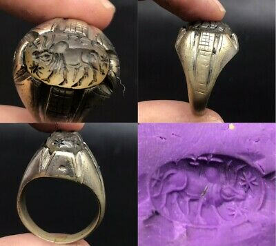 Beautiful crystal stone with animal intaglio old brass ring
