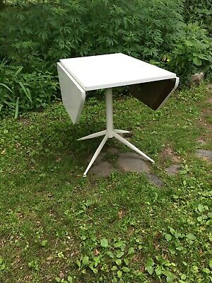 1950-60s Charles and Ray Eames, Herman Miller Era white drop leaf formica table.