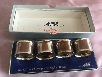 4 boxed Mason & Riley  siver plated napkin rings