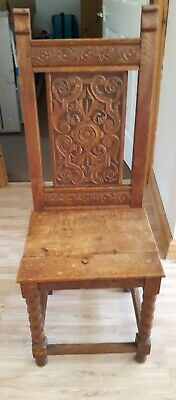 Early 20th Century oak carved high back hard seat dining chair hand carved