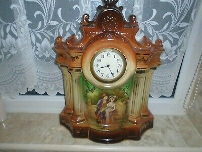 Large Pottery Antique Mantle Clock With Scene Of A Beau And His Lady