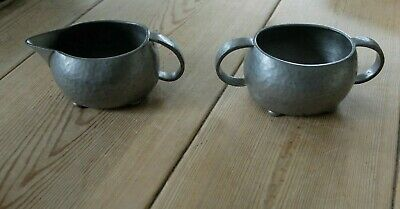 Early 20th century Liberty Tudric pewter hammered sugar bowl and creamer 01535