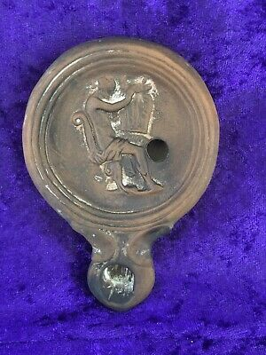 ROMAN TERRACOTTA OIL LAMP DEPICTING Sitting Person Doing Something With Clothes