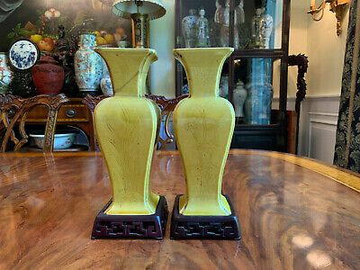 A Pair Chinese Qing Dynasty Yellow Glazed Vases with Carved Wooden Stands.