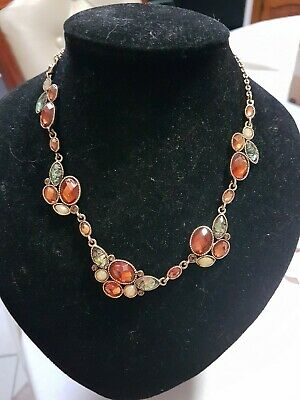 A Gold And  Red, Cream Necklace