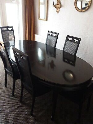 Vintage American ebonised mahogany dining table and chairs