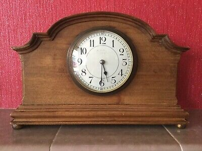 Antique French Oak Mantle Clock With Brass Feet.
