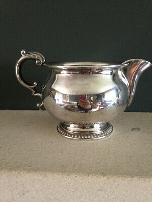 Classic vintage Mappin and Webb milk or cream jug, silver plate on copper