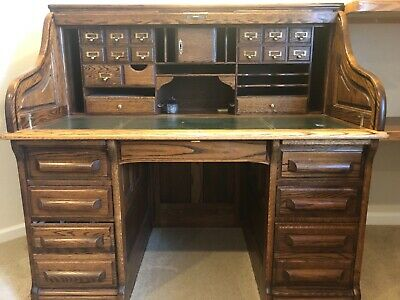 solid oak roll top desk. wood is perfect. Leather desk surface is damaged.