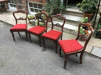 Four Victorian mahogany balloon back dining chairs in rich red chenille weave