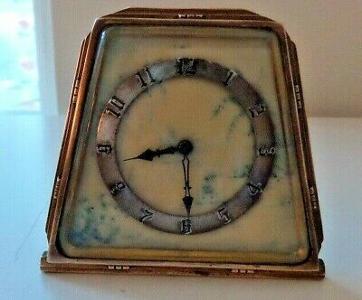 A Splendid Art Deco Period Swiss Made Small Brass Clock with a Marble Front
