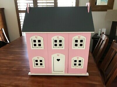 Wooden doll house. Excellent condition