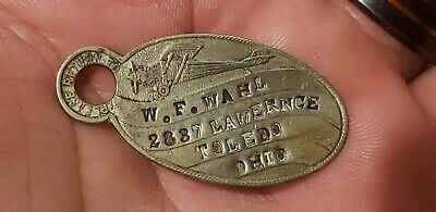 Charge Coin From W. F. Wahl Toledo, Ohio Shows An Airplane Spit Fire