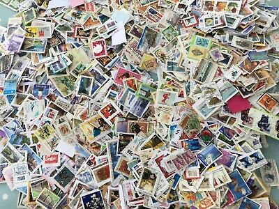 Worldwide over 1kg postage stamps 630g on and 570g off paper charity collection