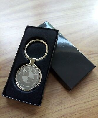 1X BRAND NEW genuine solid metal BMW keyring with dealership markings as shown.