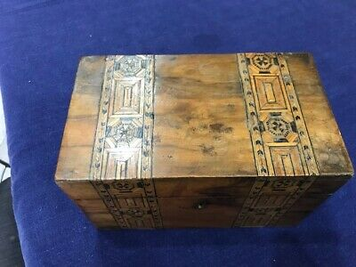 A Victorian twin compartment marqetry inlaid tea caddy.