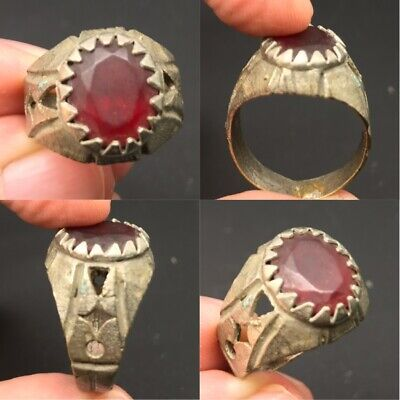 Ancient old unique bronze antique ring with old red stone